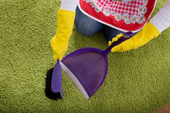 Carpet cleaning with brush and dustpan Stock Image