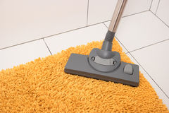 Carpet cleaning from dust. Royalty Free Stock Photo
