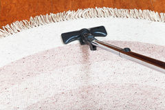 Carpet cleaning with hoover Royalty Free Stock Photo