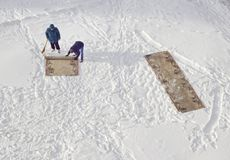 Carpet cleaning in the snow housework stock image