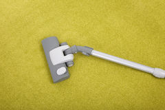 Carpet cleaning with a vacuum cleaner Stock Photos