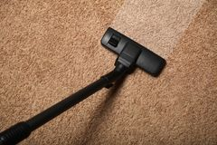 Carpet cleaning, vacuum cleaner on dirty floor royalty free stock photo