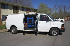 Carpet cleaning van 1. New carpet cleaning van, ready to start work at apartment complex, full side view Stock Photography