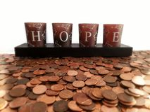 A carpet of coins and the inscription ` HOPE. Accumulation of money. Hope concept, Savings concept. Coins spread out like carpet with the inscription hope.hope stock photos