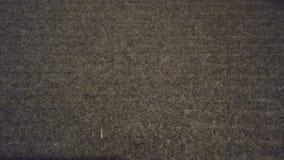 Carpet dark gray close-up, nap. Background, pattern. Close-up stock photo