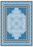 Design carpet with ethnic ornament of blue shades and a floral pattern in bluish tones in the on the middle. Carpet design with ethnic ornament of blue shades Stock Photo
