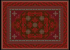 Carpet with ethnic ornament of red and burgundy shades and red floral pattern on brown on the middle. Carpet design with ethnic ornament of red and burgundy Stock Image