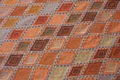 Carpet detail. Detail of african red carpet stock photos