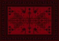 Carpet with ethnic patterned tree and birds in red and maroon shades Stock Photos
