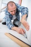 Carpet fitter at work. Man Stock Photos