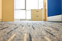 Carpet floor in a office. Focus on carpet floor in a office Stock Images