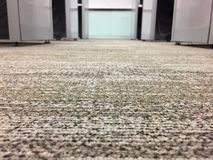 Carpet floor in office, select focus on the floor. Carpet floor in office Royalty Free Stock Photography