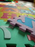 Carpet game. Colored and morbito letter carpet stock images