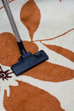 Carpet Hoovering. Hoovering of carpet in home Stock Photo