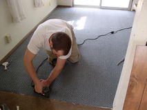 Carpet installer Royalty Free Stock Image