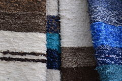Carpet market detail. Detail of the carpet market - colorful handmade carpets and rugs background stock photography