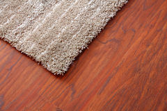 Carpet on a parquet. In a living room Royalty Free Stock Photography