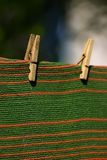 Carpet pegged to a clothesline. Red and green striped carpet pegged to a clothesline. Place for copy text Royalty Free Stock Photography