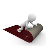 Carpet roll. A person rolls out the red carpet Royalty Free Stock Photography