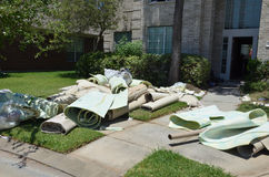 Carpet rolls. And padding removed from house stock photo
