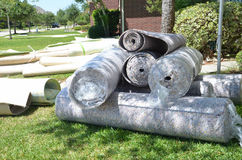 Carpet rolls. And padding removed from house Stock Image