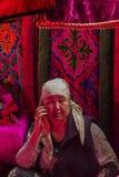 Carpet seller. Woman in the biggest market of Bishkek. The market is called Osh Bazaar Stock Image