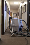 Carpet Shampooer. A professional carpet cleaning machine  in a long hallway Royalty Free Stock Images