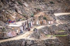Carpet shop in High Atlas Mountains. Carpet shop on a curvy dirt road in High Atlas Mountains near Imlil, Morocco Stock Images