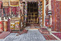 Carpet shop selling oriental rugs. Royalty Free Stock Images