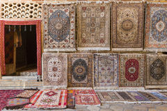 Carpet shop selling oriental rugs. Royalty Free Stock Photo