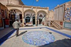 Carpet & souvenir shop in the courtyard of historical building Stock Photo