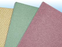 Carpet Swatches 01. Three carpet samples fanned out against a light blue gradient background Stock Photography