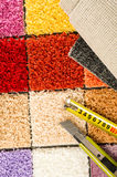 Carpet swatches, tape measure, boxcutter Royalty Free Stock Photos