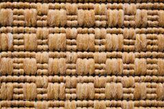 Carpet texture. Brown woolen woven carpet texture Royalty Free Stock Photography