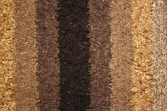 Carpet texture made of small leather pieces Stock Images
