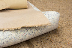 Carpet and Underlay. Section of old carpet and underlay rolled up Stock Photos