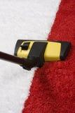 Carpet vacuuming Stock Photos