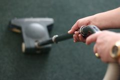 Carpet vacuuming Royalty Free Stock Photos