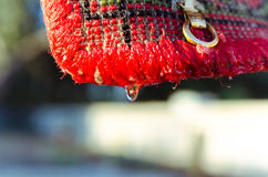Carpet after washing hanging swells. In the village on the street hangs a wet carpet dried stock photography