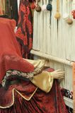 Carpet weaver model in traditional national costume with old loom Stock Images