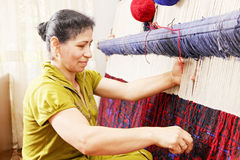 Carpet weaver sideview closeup Royalty Free Stock Photo