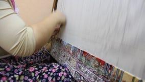 Carpet weaving. Turk woman making a silk carpet Stock Image