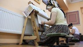 Carpet weaving. Turk woman making a silk carpet Stock Photo