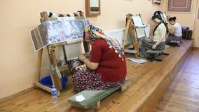 Carpet weaving. Turkish womens making a silk carpet Stock Images