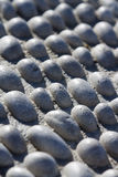 A carpet of white stones texture Stock Photography