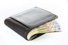 Carpeta con el dinero aislado en el fondo blanco fotografía de archivo