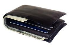 Carpeta con las tarjetas y el efectivo de crédito Fotografía de archivo libre de regalías