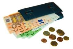Carpeta con los billetes de banco y las monedas euro Fotos de archivo libres de regalías