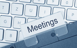 Carpeta de las reuniones en el ordenador imagenes de archivo