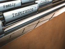 Carpeta del seguro, seguridad de la familia Foto de archivo libre de regalías